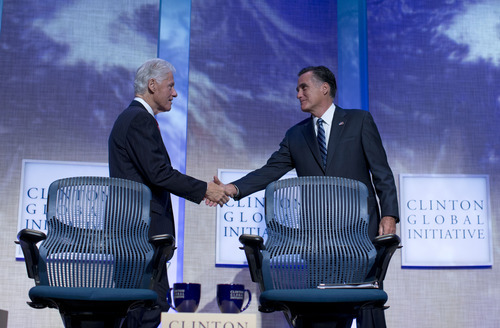 Former President Bill Clinton shakes hands with Republican presidential candidate, former Massachusetts Gov. Mitt Romney after he spoke at the Clinton Global Initiative convention in New York, Tuesday, Sept. 25, 2012.  (AP Photo/ Evan Vucci)