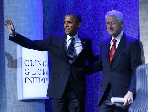 President Barack Obama and former President Bill Clinton arrive prior to President Obama speech at the Clinton Global Initiative Annual meeting in New York, Tuesday, Sept. 25, 2012. (AP Photo/Pablo Martinez Monsivais)