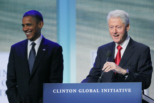 President Barack Obama reacts as he is introduced by former President Bill Clinton at the Clinton Global Initiative, Tuesday, Sept. 25, 2012, in New York. (AP Photo/Mark Lennihan)