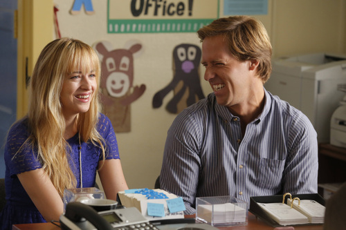 This image released by Fox shows Nat Faxon, as Ben,  right, and Dakota Johnson, as Kate, in a scene from