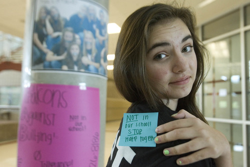 Paul Fraughton  |  The Salt Lake Tribune Rylee Steyee, a ninth-grader and student ambassador at Sunset Ridge Middle School, shows off one of the Post-it notes worn by students with a positive message against bullying. The notes were a reaction to an incident at the school where a new student had a note put on her back by another student that said,
