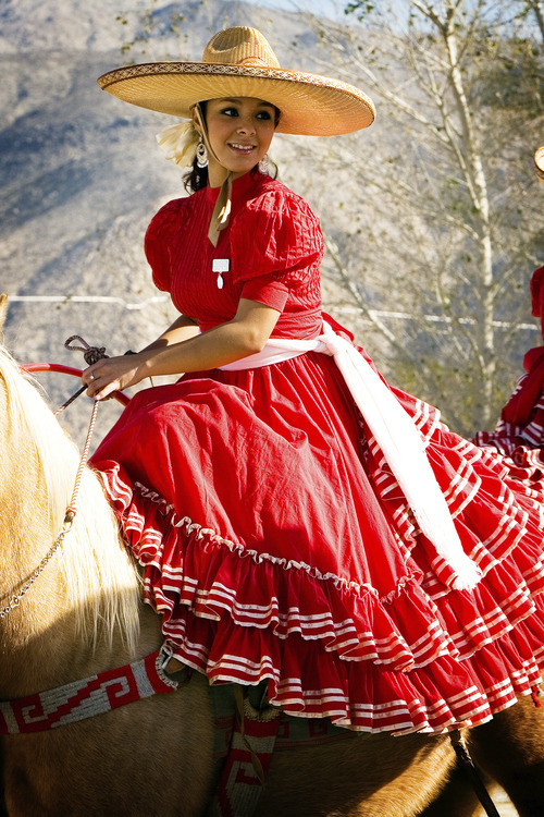 One of the riders in Escaramuzas Charra La Potosina shows off her festive traditional dress while sitting side-saddle on her horse. Fiesta Mexicana is scheduled to perform at this year's Utah State Fair. (Courtesy Fiesta Mexicana)