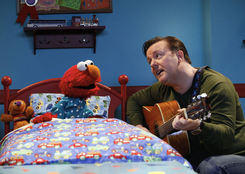 The furry red monster Elmo, seen here being serenaded by Ricky Gervais in a scene from the 40th season of