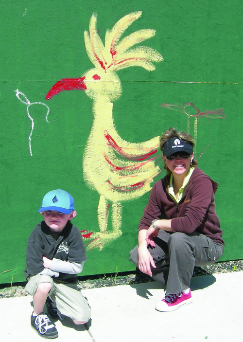 Utah 4 Kids author Samantha Simon and a child enjoy a trip to Tracy Aviary. Courtesy image