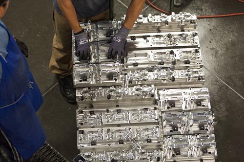Chris Detrick  |  The Salt Lake Tribune Workers organize custom fabricated metal parts at Hoyt Archery in Salt Lake City Wednesday September 12, 2012.