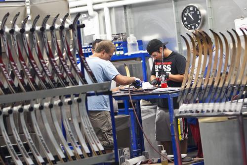 Chris Detrick  |  The Salt Lake Tribune Employees work on sanding limbs at Hoyt Archery in Salt Lake City Wednesday September 12, 2012.