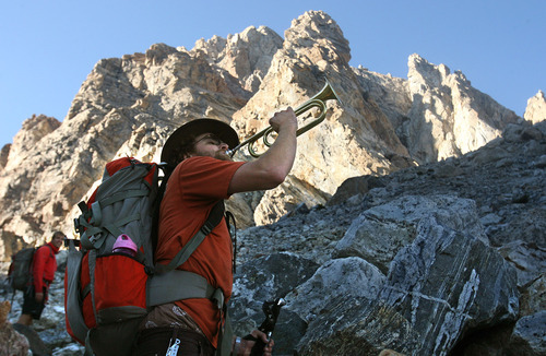 Leah Hogsten  |  The Salt Lake Tribune Chad Jukes draws a laugh from fellow climbers as he warms up his bugle on the 7-mile, 5,000-foot hike to the Lower Saddle of the Grand Teton that he planned to play at the summit.  Jukes, lost his right leg below the knee as a result of injuries he sustained in an IED attack in Iraq. When he was deciding whether to amputate, another climber told him he'd rather be an amputee than a cripple.