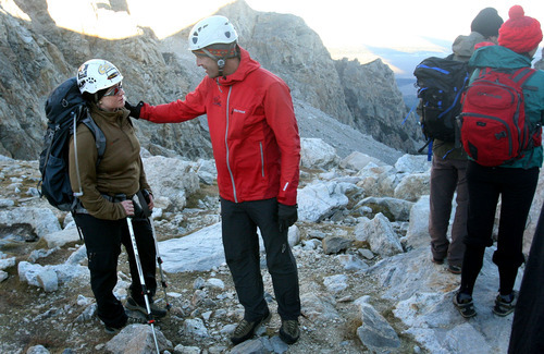 Leah Hogsten     The Salt Lake Tribune  Mike Abbey, 36, a former Force Reconnaissance Marine and mountain warfare specialist who served several tours in Iraq, reassures Nico Maroulis during the ascent of Grand Teton.