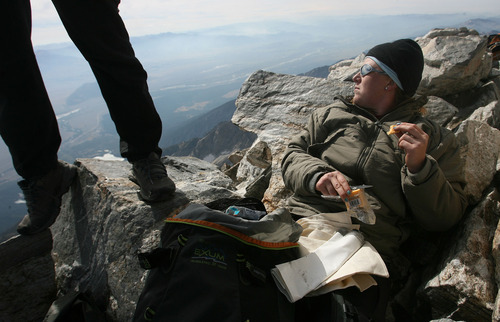 Leah Hogsten  |  The Salt Lake Tribune Nico Maroulis relaxes at the summit of the Grand Teton with fellow veterans and guides.