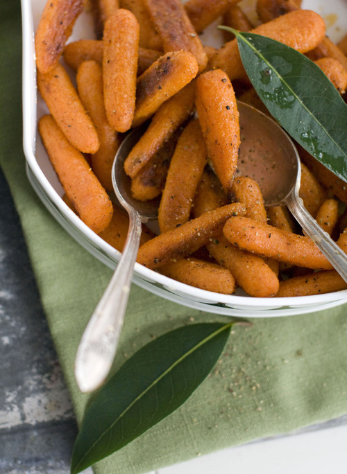 In this image taken on Sept. 10, 2012, Butter-cumin Carrots are shown in a serving dish in Concord, N.H. (AP Photo/Matthew Mead)