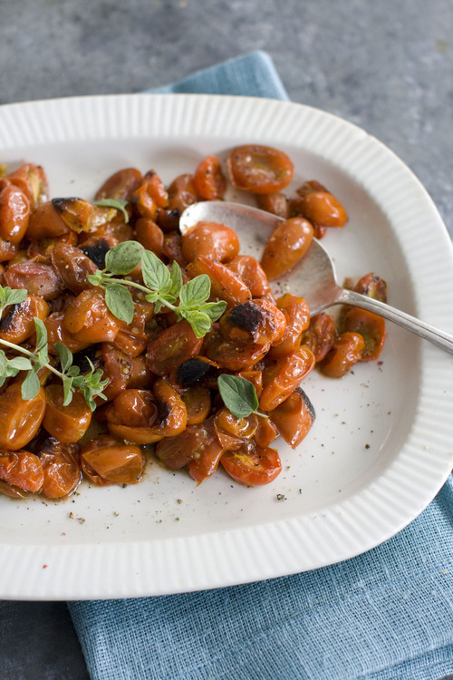 In this image taken on Sept. 10, 2012, Roasted Balsamic Cherry Tomatoes are served on a platter as shown in Concord, N.H. (AP Photo/Matthew Mead)