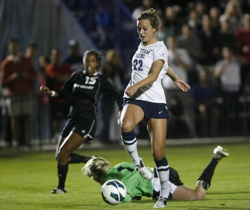 Paul Fraughton | Salt Lake Tribune  BYU's Jessica Ringwood gets to the ball before UVU's keeper Lauren Sack and kicks the ball into the back of the net for a BYU goal.BYU played Utah Valley University at BYU's field.   Thursday, September 27, 2012