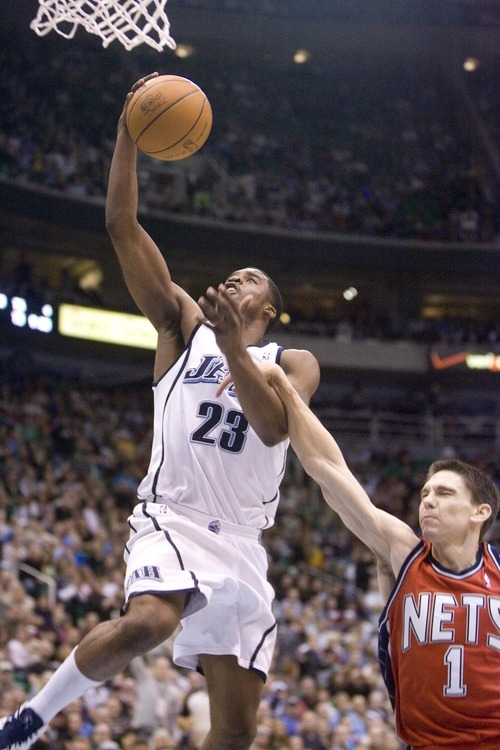 Jeremy Harmon | The Salt Lake Tribune  Utah's Wesley Matthews is fouled by New Jersey's Chris Quinn as the Jazz host the Nets at EnergySolutions Arena, Saturday, Jan. 23, 2010.