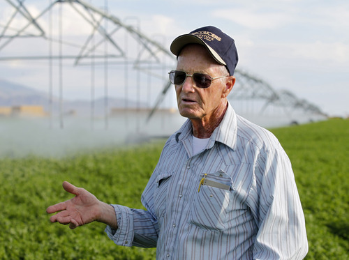 Al Hartmann  |  The Salt Lake Tribune Luck, planning and wellwater keep Dean Baker's crops alive during western Utah's worst drought on record. One thing the 72-year-ol Baker has learned through long years of family farming is that