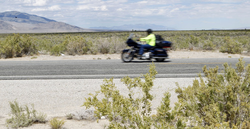 Al Hartmann  |  The Salt Lake Tribune A motorcyclist rides along U.S. Highway 50 through the parched land of western Utah. The area, like most of Utah, has been choked by drought. Data from the National Climatic Data Center says western Utah has been hardest hit.