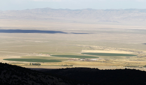 Al Hartmann  |  The Salt Lake Tribune Irrigated crop circles on the Baker ranch form a green oasis in the dust-dry land of western Utah along the Nevada state line.  Western Utah has experienced the driest 12 months in history this year despite the monsoonal rain in July and August.
