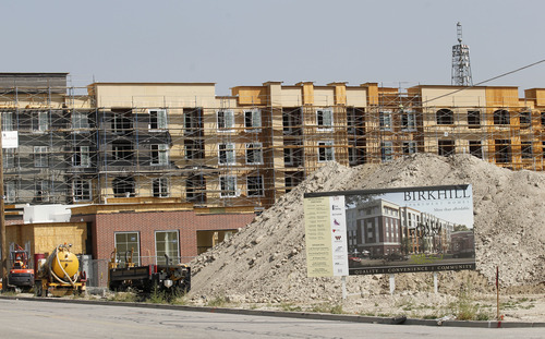 Al Hartmann  |  The Salt Lake Tribune A former field in Murray is being transformed into an urban community called Birkhill on Main. The $45 million multi-phase mixed-use development consists of high-density apartments and retail and office space. These amenities are positioned near Murray's light rail station, and the upcoming commuter-rail line to Provo that starts operating this December.  Phase 1 of Birkhill on Main, a $17 million project at 4255 S. Main rises five stories and when finished will feature 137 one- to three-bedroom apartments ranging in size from 664 to 1119 square feet.