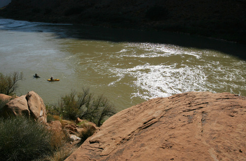 Steve Griffin | The Salt Lake Tribune   Kayakers enjoy the Colorado River near Moab. Grand and Wayne counties are charging people for search and rescues. One man received a $1,500 bill for being rescued after his raft overturned on the Colorado River. A North Carolina man received a $4,000 bill after he rescued from Bluejohn Canyon.