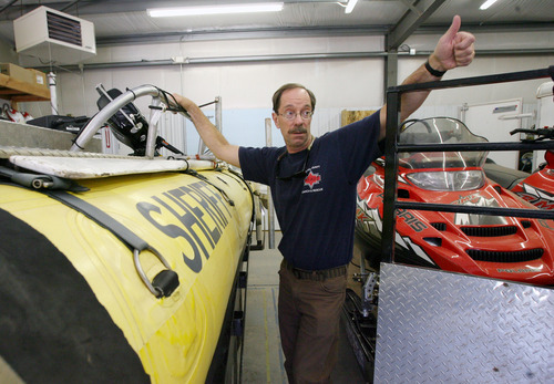 Steve Griffin   The Salt Lake Tribune   Grand County Search and Rescue commander, Jim Webster, with one of the large rafts used by his department in Moab, Utah Thursday September 13, 2012. Grand and Wayne counties are charging people for search and rescues. One man received a $1,500 bill for being rescued after his raft overturned on the Colorado River. A North Carolina man received a $4,000 bill after he rescued from Bluejohn Canyon.