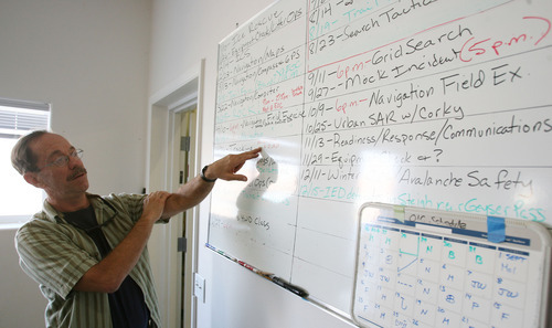 Steve Griffin | The Salt Lake Tribune   Grand County Search and Rescue commander, Jim Webster, points out the training schedule at the search and rescue offices in Moab, Utah Thursday September 13, 2012. Grand and Wayne counties are charging people for search and rescues. One man received a $1,500 bill for being rescued after his raft overturned on the Colorado River. A North Carolina man received a $4,000 bill after he rescued from Bluejohn Canyon.