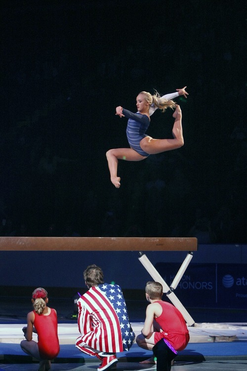 Chris Detrick  |  The Salt Lake Tribune Nastia Liukin performs on the beam during Kellogg's Tour Of Gymnastics Champions at the Maverik Center in West Valley City on Thursday, Sept. 27, 2012. The 40-city tour runs through Nov. 18.