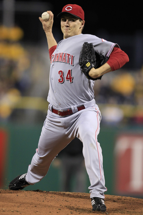 Cincinnati Reds starting pitcher Homer Bailey (34) delivers during the first inning of a baseball game against the Pittsburgh Pirates in Pittsburgh Friday, Sept. 28, 2012.(AP Photo/Gene J. Puskar)