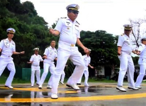 In this image made from an undated video released by Thai Royal Navy, Thai sailors perform the rodeo-style dance and other hip-shaking moves at their base on the popular tourist island of Phuket, southern Thailand. The