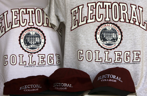 FILE - In this Oct. 28, 2008 file photo, sportswear bearing the name of a college that doesn't exist: the Electoral College, are seen in Glenburn, Maine, on Tuesday, Oct. 28, 2008. When it comes to voting for president, not all votes are created equal. Chances are yours will count less than a select few. Each state's Electoral College votes are based on the size of its congressional delegation, not its population. Because of that, a presidential vote in Wyoming mathematically counts more than three times as much as a vote in Ohio, at least in terms of choosing electors.(AP Photo/Pat Wellenbach, File)