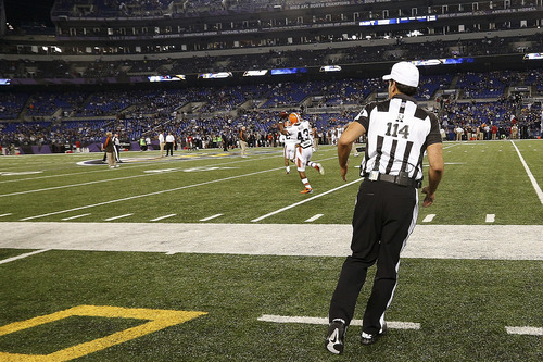 Referee Gene Steratore runs onto the field before an NFL football game between the Baltimore Ravens and Cleveland Browns in Baltimore, Thursday, Sept. 27, 2012. (AP Photo/Patrick Semansky)