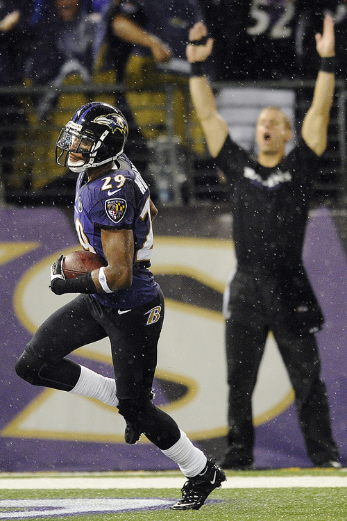 Baltimore Ravens cornerback Cary Williams returns an interception for a touchdown during the second half of an NFL football game against the Cleveland Browns in Baltimore, Thursday, Sept. 27, 2012. (AP Photo/Nick Wass)