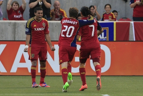 From left, Javier Morales, Ned Grabavoy (20) and Fabian Espindola (7) of Real Salt Lake celebrate Espindola's goal against the Portland Timbers in the first half of an MLS soccer game Saturday, Sept. 22, 2012, in Sandy, Utah. (AP Photo/Rick Bowmer)