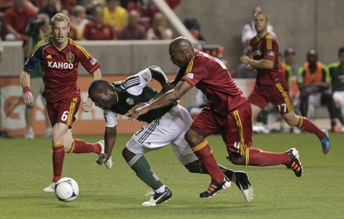 Portland Timbers' Bright Dike (19) battles for control of the ball with Real Salt Lake's Jamison Olave (4) while teammate Nat Borchers (6) looks on in the second half of an MLS soccer game Saturday, Sept. 22, 2012, in Sandy, Utah. Real Salt Lake defeated Portland Timbers 2-1. (AP Photo/Rick Bowmer)
