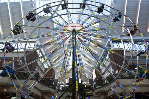 Chris Detrick  |  The Salt Lake Tribune The Ferris wheel at Scheels Saturday September 29, 2012. Scheels opened its 220,000-square-foot mega-sporting goods store in Sandy. Featuring a 16-car Ferris wheel rising toward a skylight, a 16,000-gallon double-arched salt water aquarium, a boating department, game centers and a focus on fashionable apparel, the store is meant to be a fun destination, said Dan Hermanson, an assistant store leader.