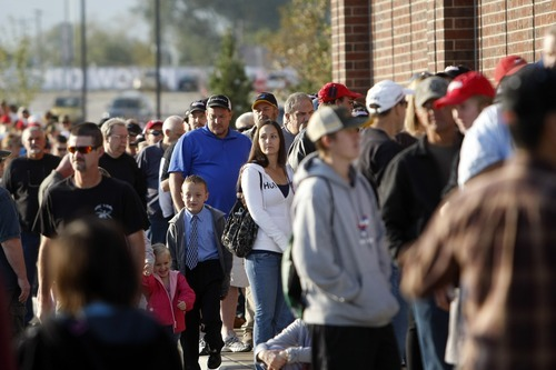 Chris Detrick  |  The Salt Lake Tribune Customers wait in line to get into Scheels Saturday September 29, 2012. Scheels opened its 220,000-square-foot mega-sporting goods store in Sandy. Featuring a 16-car Ferris wheel rising toward a skylight, a 16,000-gallon double-arched salt water aquarium, a boating department, game centers and a focus on fashionable apparel, the store is meant to be a fun destination, said Dan Hermanson, an assistant store leader.