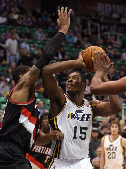 Steve Griffin  |  The Salt Lake Tribune  Utah Jazz forward Derrick Favors spins to the basket during first half action of the Utah Jazz versus Portland Trail Blazers game at EnergySolutions Arena in Salt Lake City, Utah Wednesday, December 21, 2011.