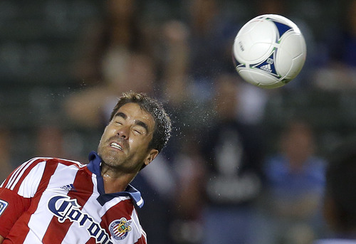 Chivas USA's Juan Pablo Angel heads the ball in the first half of an MLS soccer game against Real Salt Lake in Carson, Calif., Saturday, Sept. 29, 2012. (AP Photo/Jae C. Hong)