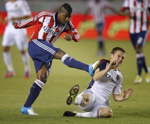Chivas USA's Miller Bolanos, left, kicks Real Salt Lake's Will Johnson during the first half of an MLS soccer game in Carson, Calif., Saturday, Sept. 29, 2012. (AP Photo/Jae C. Hong)