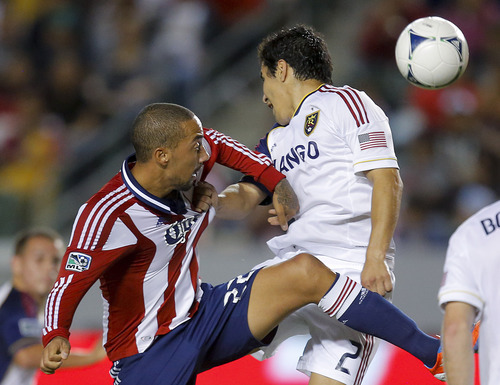 Real Salt Lake's Tony Beltran, right, grabs the jersey of Chivas USA's Ryan Smith as they fight for the ball in the first half of an MLS soccer game in Carson, Calif., Saturday, Sept. 29, 2012. (AP Photo/Jae C. Hong)