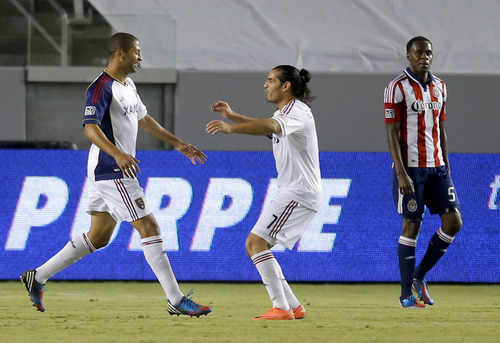 Real Salt Lake's Alvaro Saboru, left, celebrates his goal with Fabian Espindola during the first half of an MLS soccer game in Carson, Calif., Saturday, Sept. 29, 2012. At right is Chivas USA's John Valencia. (AP Photo/Jae C. Hong)