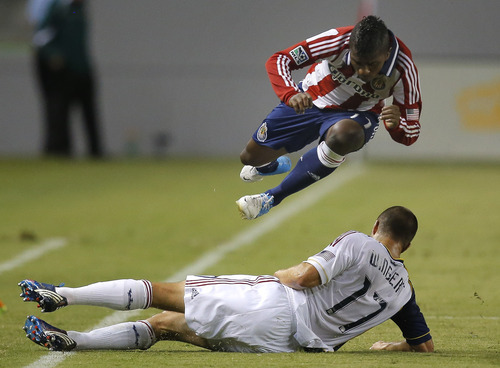 Chivas USA's Miller Bolanos, top, avoids a tackle from Real Salt Lake's Chris Wingert during the first half of an MLS soccer game in Carson, Calif., Saturday, Sept. 29, 2012. (AP Photo/Jae C. Hong)