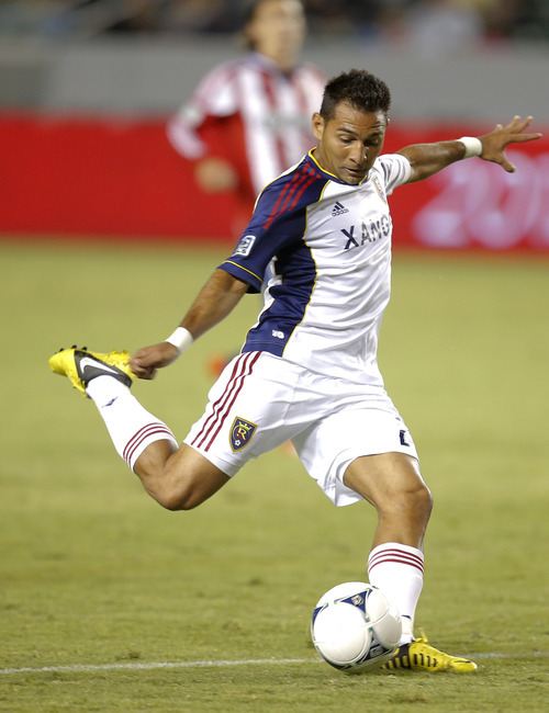 Real Salt Lake's Paulo Jr. shoots to score against the Chivas USA in the second half of an MLS soccer game in Carson, Calif., Saturday, Sept. 29, 2012. The Real Salt Lake won 4-0. (AP Photo/Jae C. Hong)