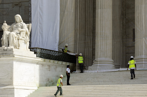 The Supreme Court building in Washington, Thursday, Sept. 27, 2012, under a protective scrim, as work continues on the facade. The Supreme Court is embarking on a new term beginning Monday that could be as consequential as the last one with the prospect for major rulings about affirmative action, gay marriage and voting rights. (AP Photo/Alex Brandon)