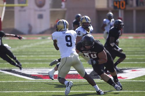 Kyle Kester | SUU Journal Southern Utah defensive lineman Cody Larsen attempts to sack Montana State University  quarterback DaNarius McGhee.