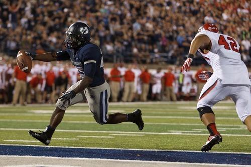 Trent Nelson  |  The Salt Lake Tribune Utah State's Kerwynn Williams scores the go-ahead touchdown in overtime as Utah State hosted the University of Utah in Logan on Sept. 7, 2012.