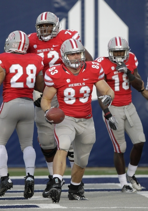 UNLV tight end Max Johnson (83) celebrates after his touch down in the second quarter of an NCAA college football game with Utah State Saturday, Sept. 29, 2012, in Logan, Utah.  (AP Photo/Rick Bowmer)