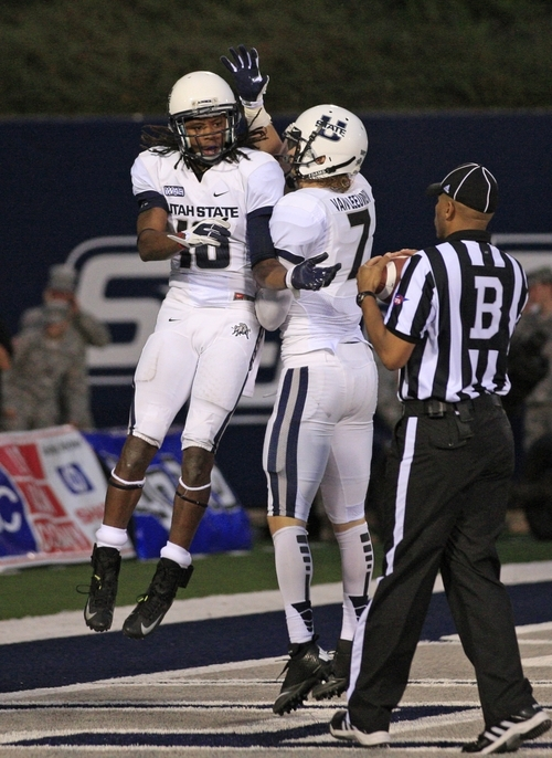 Utah State wide receiver Chuck Jacobs (10) and Utah State wide receiver Travis Van Leeuwen (7) celebrate after his touch down in the second quarter of an NCAA college football game with UNLV Saturday, Sept. 29, 2012, in Logan, Utah.  (AP Photo/Rick Bowmer)