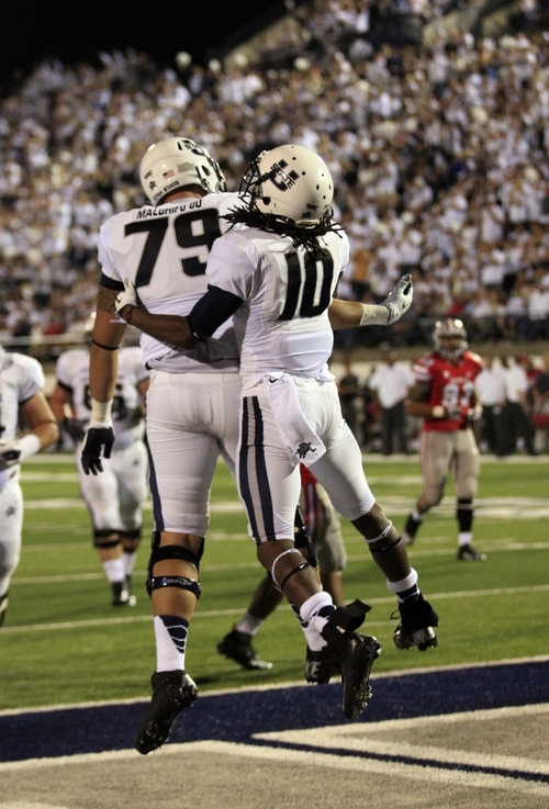 Utah State wide receiver Chuck Jacobs (10) and Utah State offensive linesman Logan Malohifo'ou (79) celebrate after his score in the fourth quarter of an NCAA college football game Saturday, Sept. 29, 2012, in Logan, Utah.  (AP Photo/Rick Bowmer)