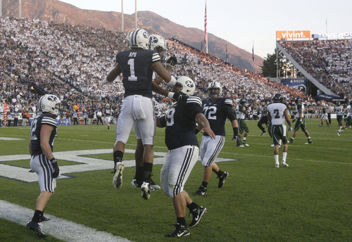 Brigham Young wide receiver Ross Apo (1) celebrates with teammates after scoring in the second quarter of an NCAA college football game against Hawaii on Friday, Sept. 28, 2012, in Provo, Utah. (AP Photo/Rick Bowmer)