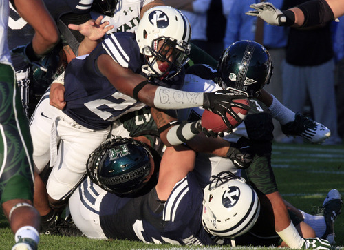 Brigham Young running back Jamaal Williams (21) scores in the first quarter of an NCAA college football game against Hawaii on Friday, Sept. 28, 2012, in Provo, Utah.  (AP Photo/Rick Bowmer)