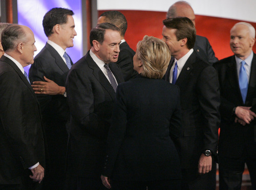 FILE - In this Jan. 5, 2008, file photo Republican presidential hopeful, former Massachusetts Gov. Mitt Romney, is greeted by Democratic presidential hopeful, Sen. Barack Obama, D-Ill., respectively second and third from left, while on stage with other Democratic and Republican presidential hopefuls during a break in the debate at St. Anselm College in Manchester, N.H. When they stand side by side on the presidential debate stage Wednesday night, Oct. 3, 2012, it will be one of the few times Obama and Romney have ever even met in person. Others from left are former New York City Mayor Giuliani, former Arkansas Gov. Mike Huckabee, former New Mexico Gov. Bill Richardson, and Sen. John McCain, R-Ariz. former New York City Mayor Rudy Giuliani, Republican presidential hopeful, former Massachusetts Gov. Mitt Romney, Republican presidential hopeful, former Arkansas Gov. Mike Huckabee, Sen. Hillary Clinton, D-N.Y., former Sen. John Edwards, D-N.C.,former Sen. Fred Thompson, and Sen. John McCain, R-Ariz.(AP Photo/Steven Senne, File)
